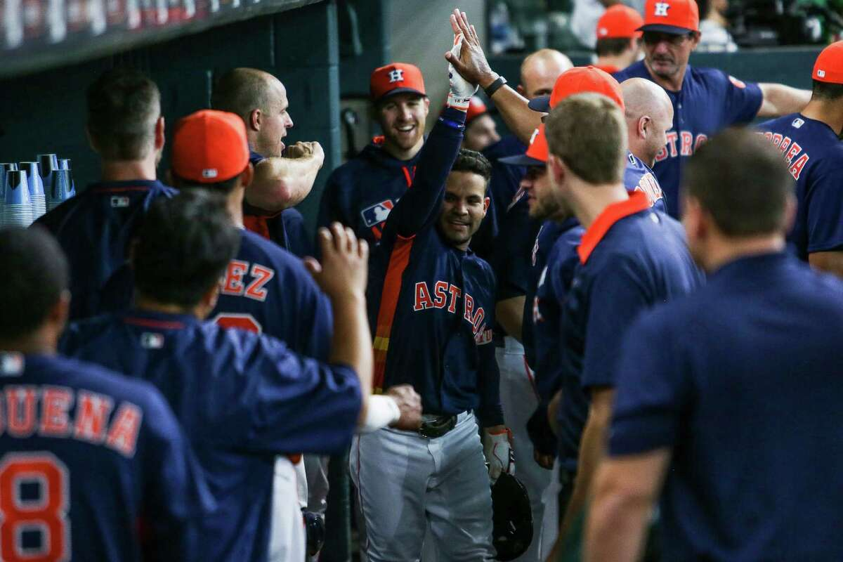 Houston Astros second baseman Jose Altuve (27) is congratulated in the dugout after hitting a home run in the first inning as the Astros take on the Tigers at Minute maid Park Sunday, April 17, 2016 in Houston.