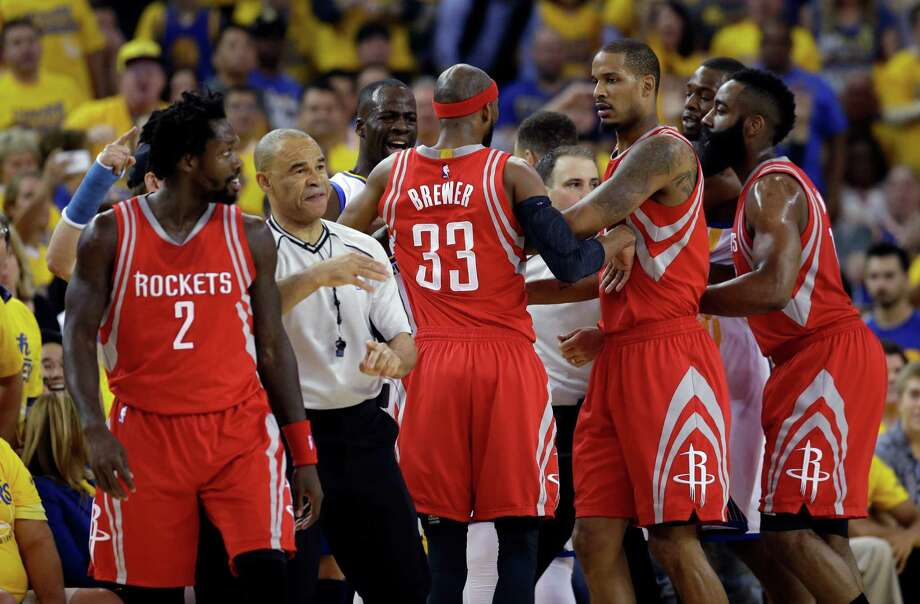 Members of the Houston Rockets and Golden State Warriors shove each other during the first half in Game 1 of a first-round NBA basketball playoff series Saturday, April 16, 2016, in Oakland, Calif. (AP Photo/Marcio Jose Sanchez) Photo: Marcio Jose Sanchez, Associated Press / AP
