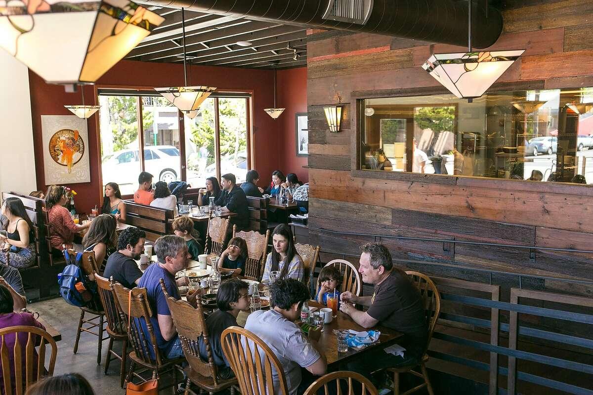A full dining room for brunch at Cafe Eugene in Albany.