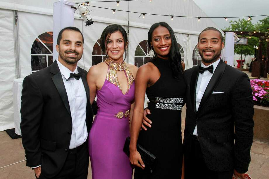 Ulises and Karen Martin, from left, with Shanika Hamilton and Kendale Rayford at the Zoo Ball.  (For the Chronicle/Gary Fountain, April 16, 2016) Photo: Gary Fountain, Gary Fountain/For The Chronicle / Copyright 2016 Gary Fountain