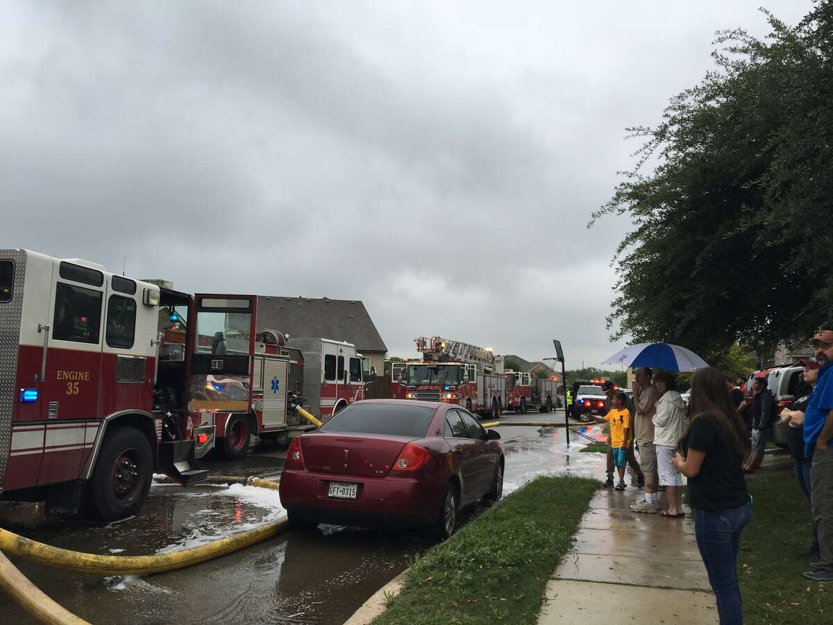 San Antonio firefighters fight a house fire on the far West Side that was sparked by a suspected lightning strike Sunday, April 17, 2016.