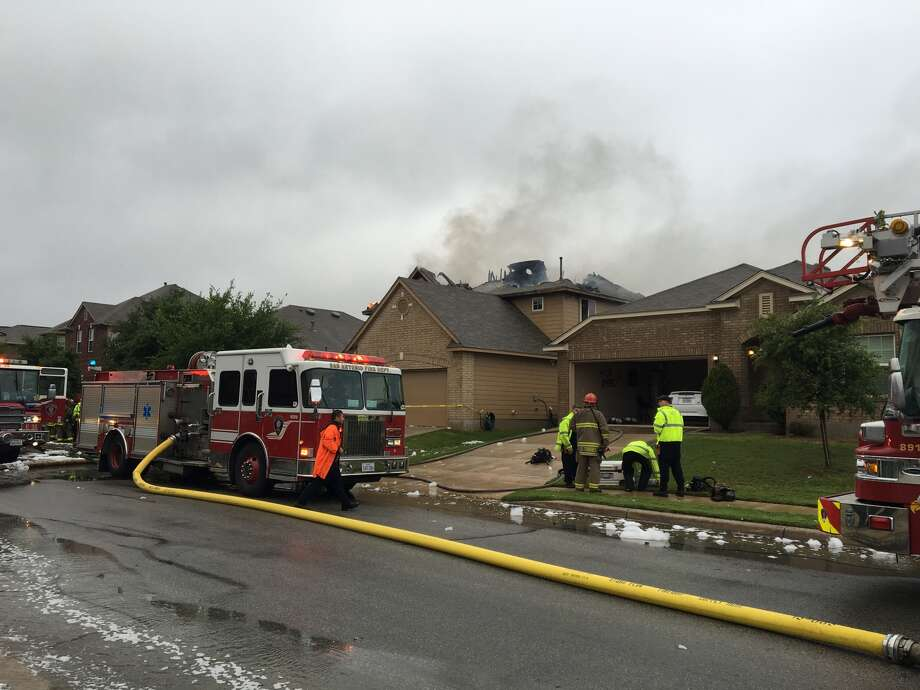 San Antonio firefighter fight a house fire on the far West Side that was sparked by a suspected lightning strike Sunday, April 17, 2016. Photo: Alexa Tavarez