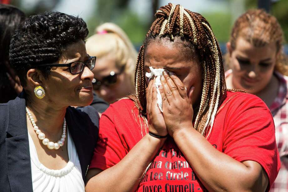 Geneva Reed-Veal, left, mother of Sandra Bland, and her daughter, Shavon Bland, stand together during a ceremony renaming University Boulevard to Sandra Bland Parkway on Friday, April 15, 2016, in Prairie View. The street was renamed near the location where Bland, who died in custody at the Waller County Jail, was arrested. Photo: Brett Coomer, Houston Chronicle / © 2016 Houston Chronicle