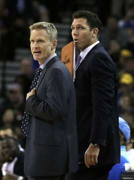 FILE - In this March 12, 2016 file photo, Golden State Warriors coach Steve Kerr, left, and assistant coach Luke Walton watch during the second half of the team's NBA basketball game against the Phoenix Suns in Oakland, Calif. Steve Kerr makes one thing perfectly clear: This special season is not about him. He doesn't want it that way, even if everybody comes back to his connections with the last NBA team to win so many games, those 1995-96 Bulls. (AP Photo/Ben Margot, File)