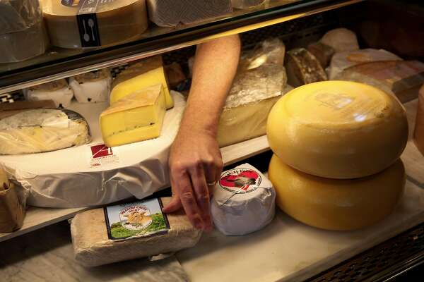 Omar MuellerÊstocks his case at Freestone Artisan Cheese, in Freestone, Calif., on Thursday, April 7, 2015.