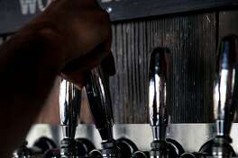Bartender Eric Odgers pours a taster at Taps in Petaluma, Calif., on Tuesday, April 12, 2015.