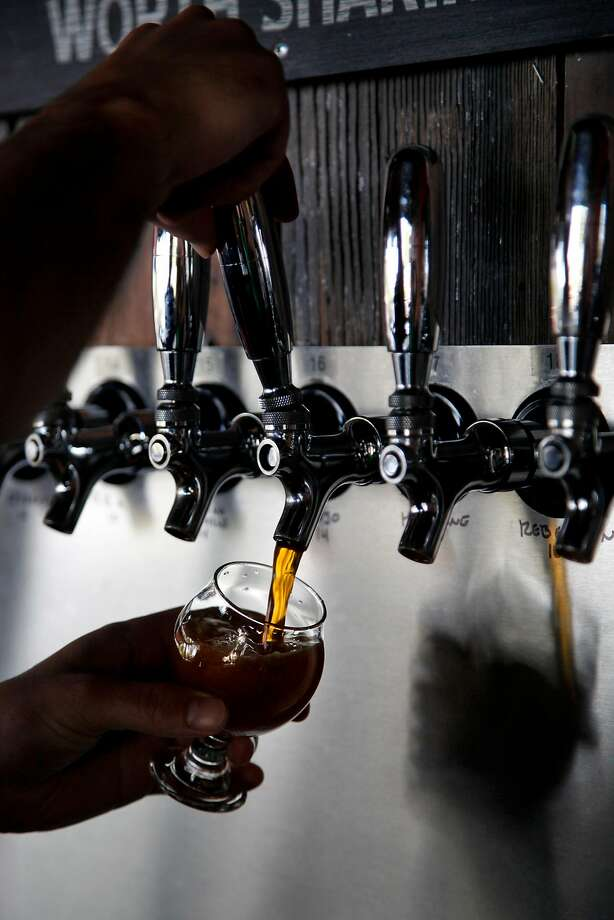 Bartender Eric Odgers pours a taster at Taps in Petaluma, Calif., on Tuesday, April 12, 2015. Photo: Preston Gannaway, GRAIN/Special To The Chronicle