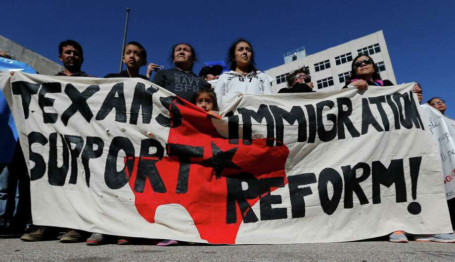 Demonstrators backing President Barack Obama's proposals to shield millions of immigrants from deportation and provide them with work permits march in Austin in November. A lawsuit over Obama's program goes before the Supreme Court today. Photo: San Antonio Express-News / File Photo / ©2015 San Antonio Express-News