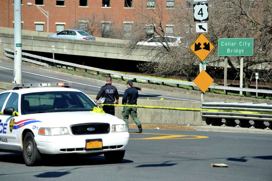 Troy police investigate an incident Sunday April 17, 2016, that involved a suspect allegedly pinning a Troy police officer with his car, ending with the officer shooting into the car and killing the suspect. (Paul Buckowski / Times Union)
