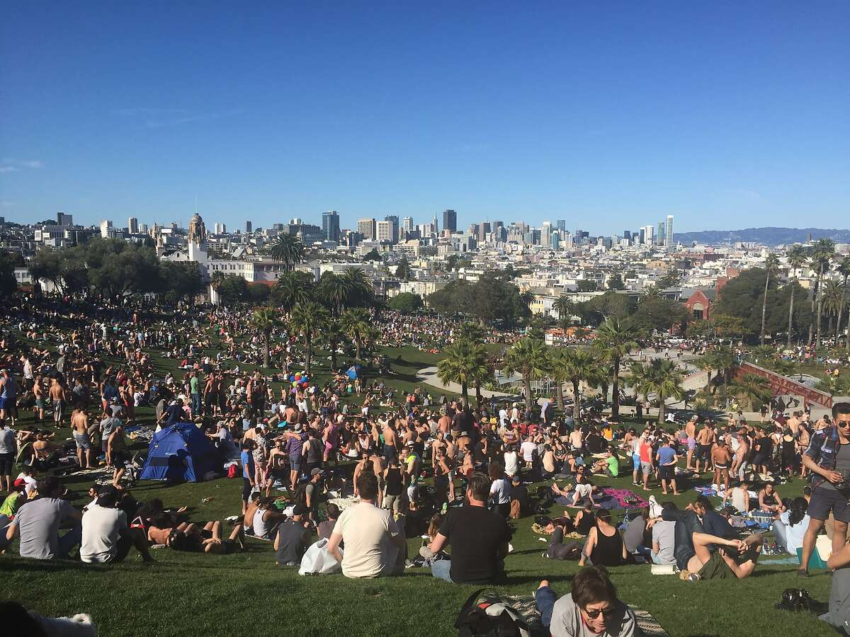 The weekend's warm weather brought out the large crowds lounging at Dolores Park on Saturday, April 16, 2016.