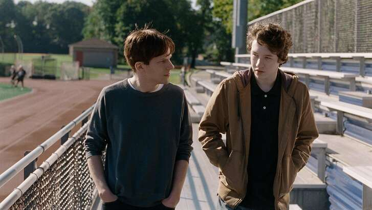 "This image released by The Orchard shows Jesse Eisenberg, left, and Devin Druid in a scene from ""Louder Than Bombs."" (The Orchard via AP)"