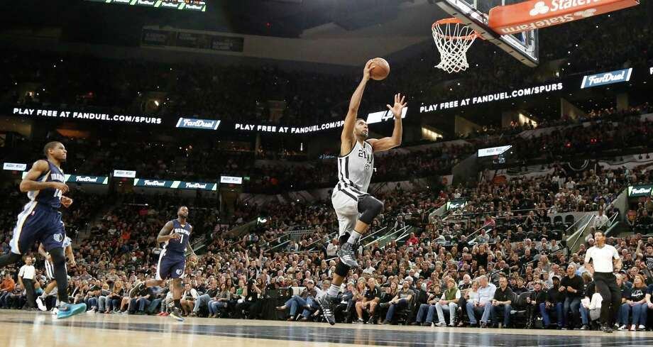 SAN ANTONIO,TX - APRIL 17: Tim Duncan #21 of the San Antonio Spurs scores against the Memphis Grizzlies in Game One of the Western Conference Quarterfinals during the 2016 NBA Playoffs at AT&T Center on April 17, 2016 in San Antonio, Texas.  NOTE TO USER: User expressly acknowledges and agrees that by downloading and or using this photograph, User is consenting to the terms and conditions of the Getty Images License Agreement. Photo: Ronald Cortes, Getty Images / 2016 Getty Images