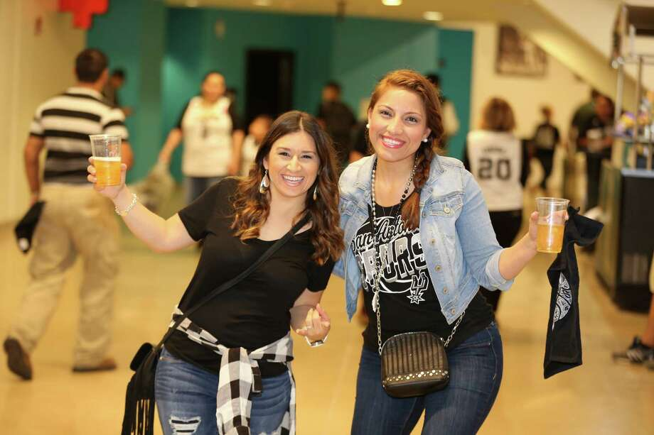 Spurs fans were gushing with joy as the boys in Silver and Black dominated the Memphis Grizzlies during Game 1 of the first round playoff matchup at the AT& Center Sunday, April 17, 2016. Photo: Mysa, Marco Garza / 2015 Give Me a Shot San Antonio,Texas United States