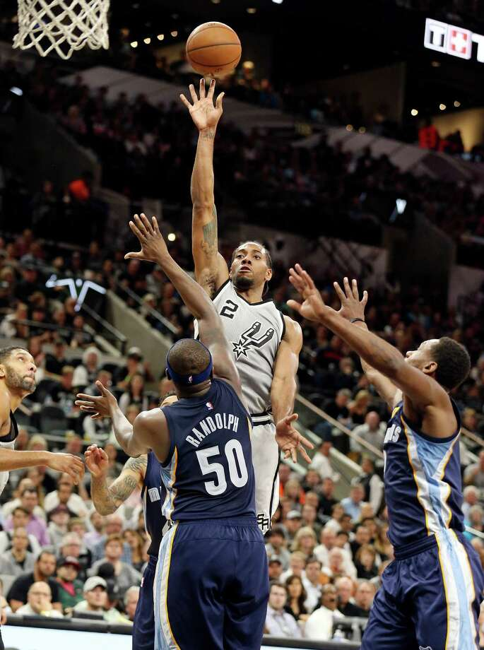 San Antonio Spurs' Kawhi Leonard shoots over Memphis Grizzlies' Zach Randolph as San Antonio Spurs' Tim Duncan (left) and Memphis Grizzlies' Tony Allen look on during first half action of Game 1 in the first round of the Western Conference playoffs Sunday April 17, 2016 at the AT&T Center. Photo: Edward A. Ornelas, Staff / San Antonio Express-News / © 2016 San Antonio Express-News