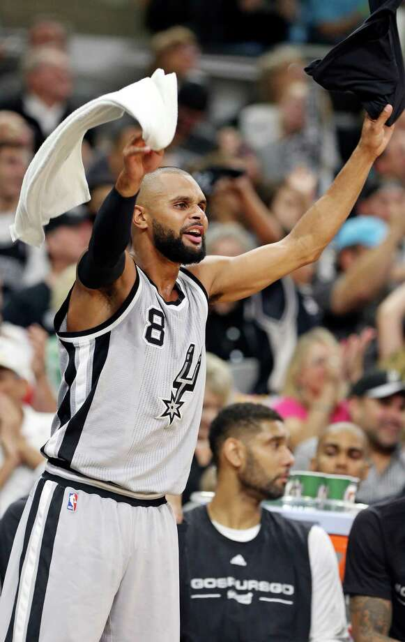 San Antonio Spurs' Patty Mills celebrates after a basket while on the bench during second half action of Game 1 in the first round of the Western Conference playoffs against the Memphis Grizzlies Sunday April 17, 2016 at the AT&T Center. Photo: Edward A. Ornelas, Staff / San Antonio Express-News / © 2016 San Antonio Express-News
