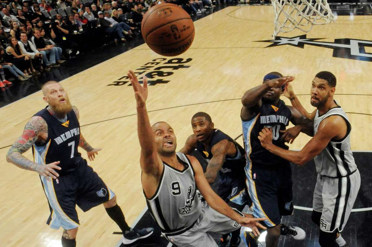 San Antonio Spurs' Tony Parker shoots as Memphis Grizzlies' Chris Andersen (from left), Xavier Munford, Zach Randolph, and Tim Duncan look on during Game 1 in the first round of the Western Conference playoffs Sunday April 17, 2016 at the AT&T Center. The Spurs won 106-74.