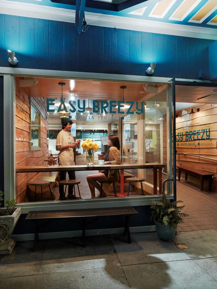 Easy Breezy has three yogurt shops in San Francisco. The Noe Valley location on 24th Street is pictured. The sidewalk bench is portable and brought out on sunny days. It must be brought back into the store at night. Owner Ariel Ford would like to install a permanent bench at her Irving store but isn't moving forward due to the city's involved permitting process. Photo: Courtesy Easy Breezy