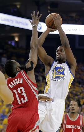 Harrison Barnes (40) puts up a shot over James Harden (13) as the Golden State Warriors played the Houston Rockets in game 1 of the first round of the Western Conference Playoffs at Oracle Arena in Oakland, Calif., on Saturday, April 16, 2016.
