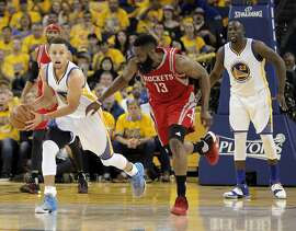 Stephen Curry (30) steals the ball away from James Harden (13) before twisting his ankle on the play in the second quarter as the Golden State Warriors played the Houston Rockets in game 1 of the first round of the Western Conference Playoffs at Oracle Arena in Oakland, Calif., on Saturday, April 16, 2016.