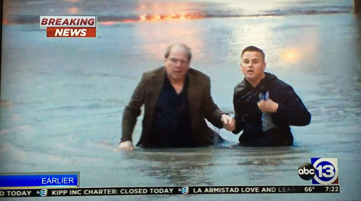 ABC13 reporter Steve Campion helps a motorist to safety early April 18, 2016. The motorist was stuck in a submerged vehicle near Studemont Street in Houston's Heights neighborhood. Campion was able to help the man to safety just seconds before his car became fully submerged.