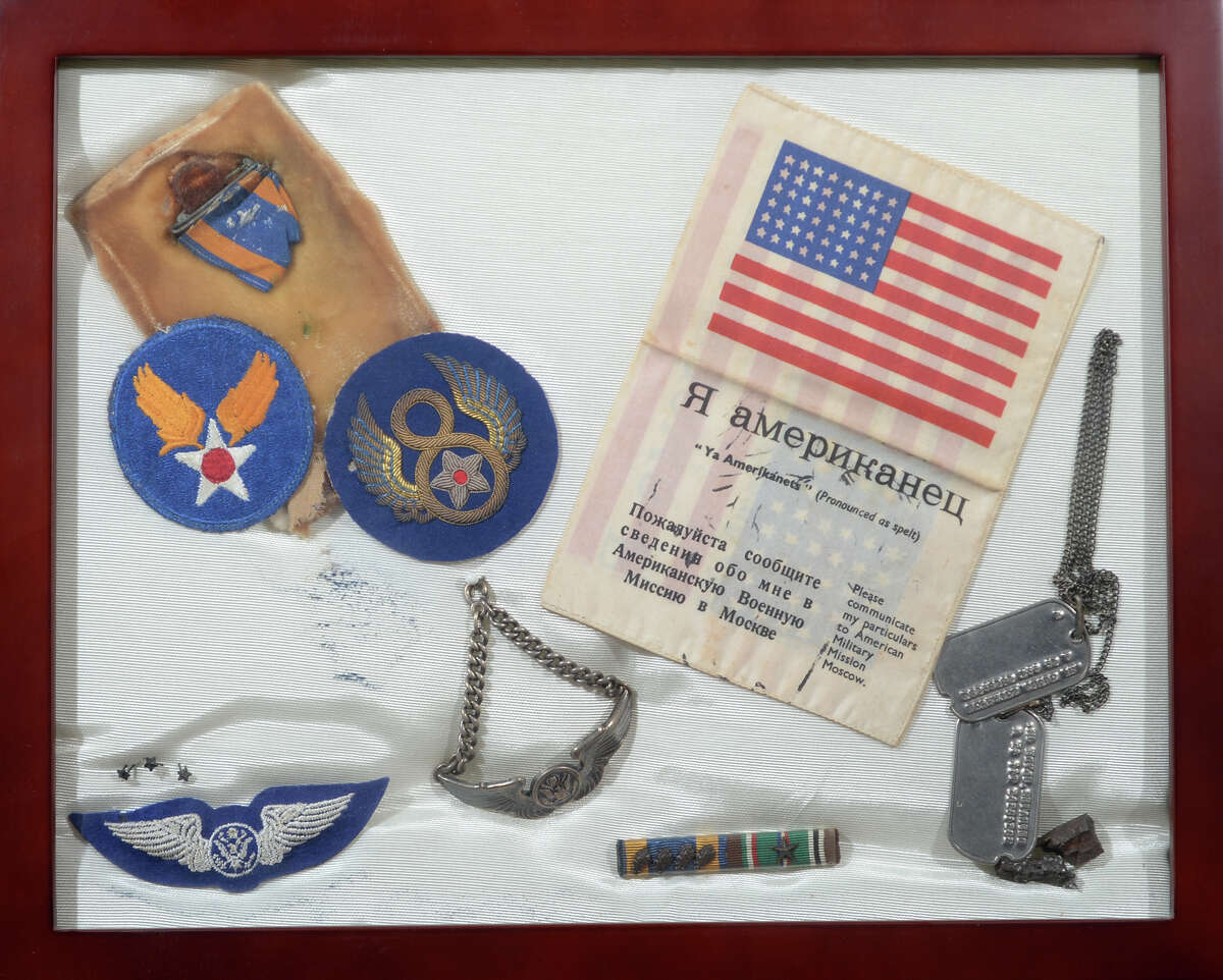 Items collected by Clyde DeFrates' while working as a ball-turret gunner for the U.S. Air Force. DeFrates will be flown to Washington D.C. later this month to visit the World War II Memorial. DeFrates served in WWII as ball-turret gunner in a B-17 bomber. A graduate of Port Arthur, DeFrates flew 33 missions including a bombing run over Berlin in February of 1945. Photo taken Thursday, April 15, 2016 Guiseppe Barranco/The Enterprise