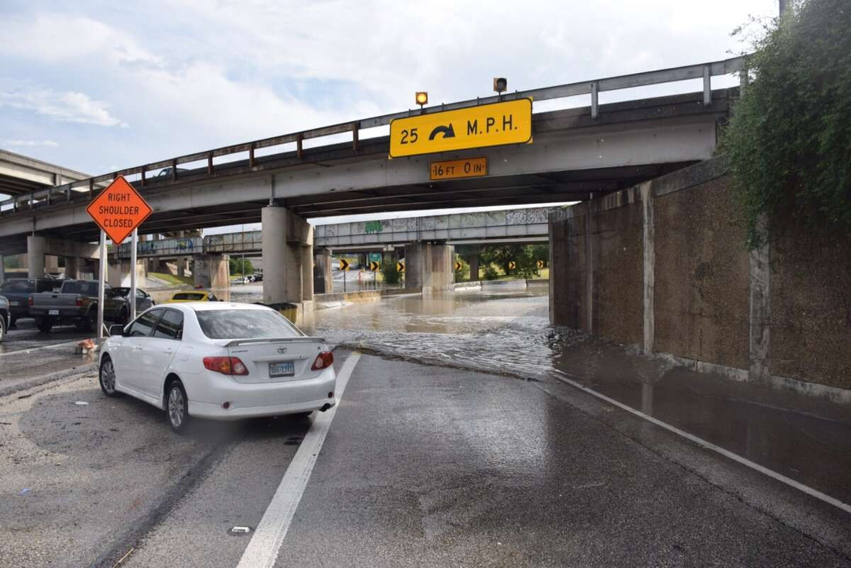 Heavy rain caused water to completely cover the road at the Interstate 35 and Loop 410 interchange on the Northeast Side, April 18, 2016.