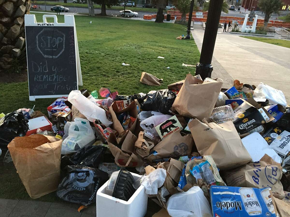 Dolores Park was littered with trash on the morning of Monday, April 18, 2016, after the weekend's warm weather attracted large crowds. Here a heap of trash is pictured next to a sign asking park-goers to pack out their trash.