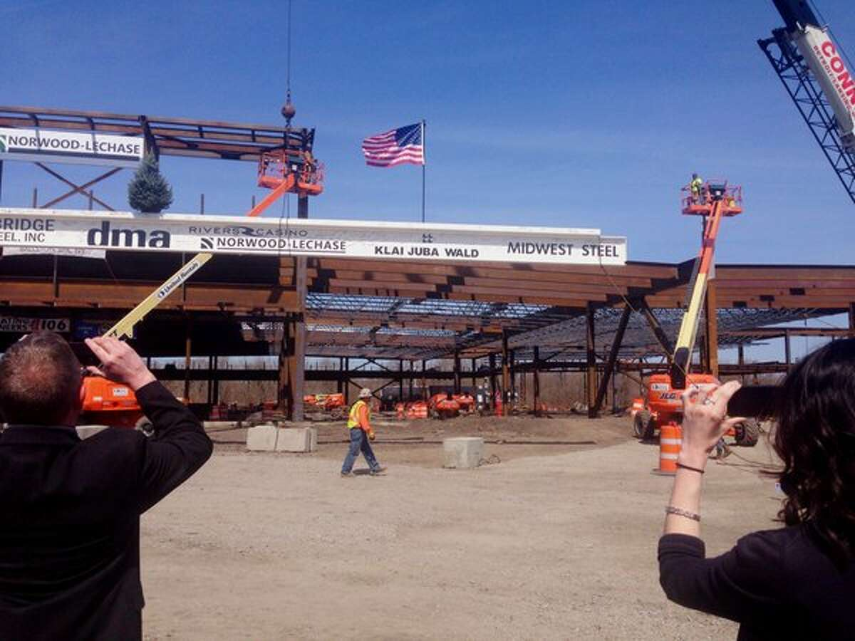The final 60-foot steel beam is installed at Rivers Casino & Resort in Schenectady on Monday, April 18, 2016. (Paul Buckowski/Times Union)