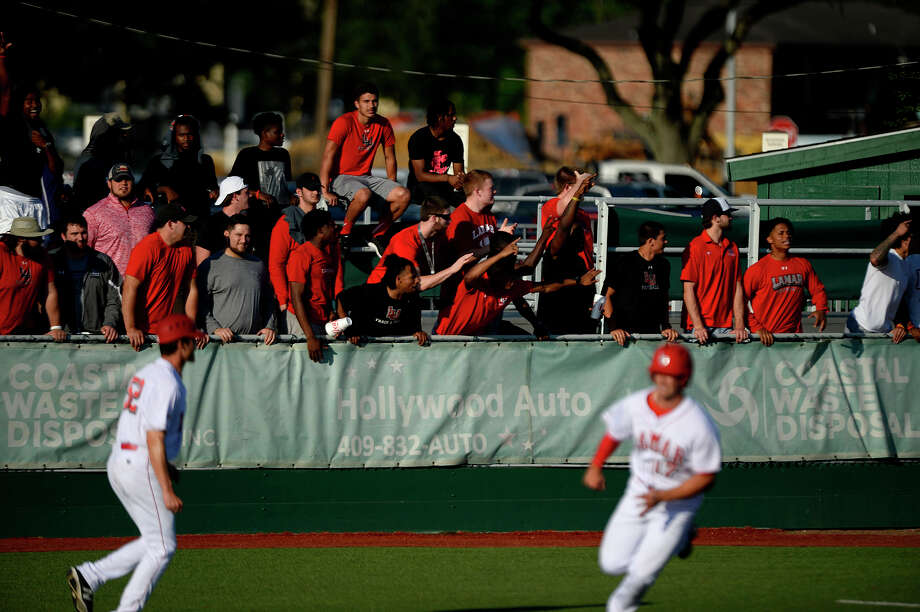 Lamar football players cheer on their baseball team against McNeese State on Friday evening. Photo taken Friday 4/15/16 Ryan Pelham/The Enterprise Photo: Ryan Pelham / ©2016 The Beaumont Enterprise/Ryan Pelham