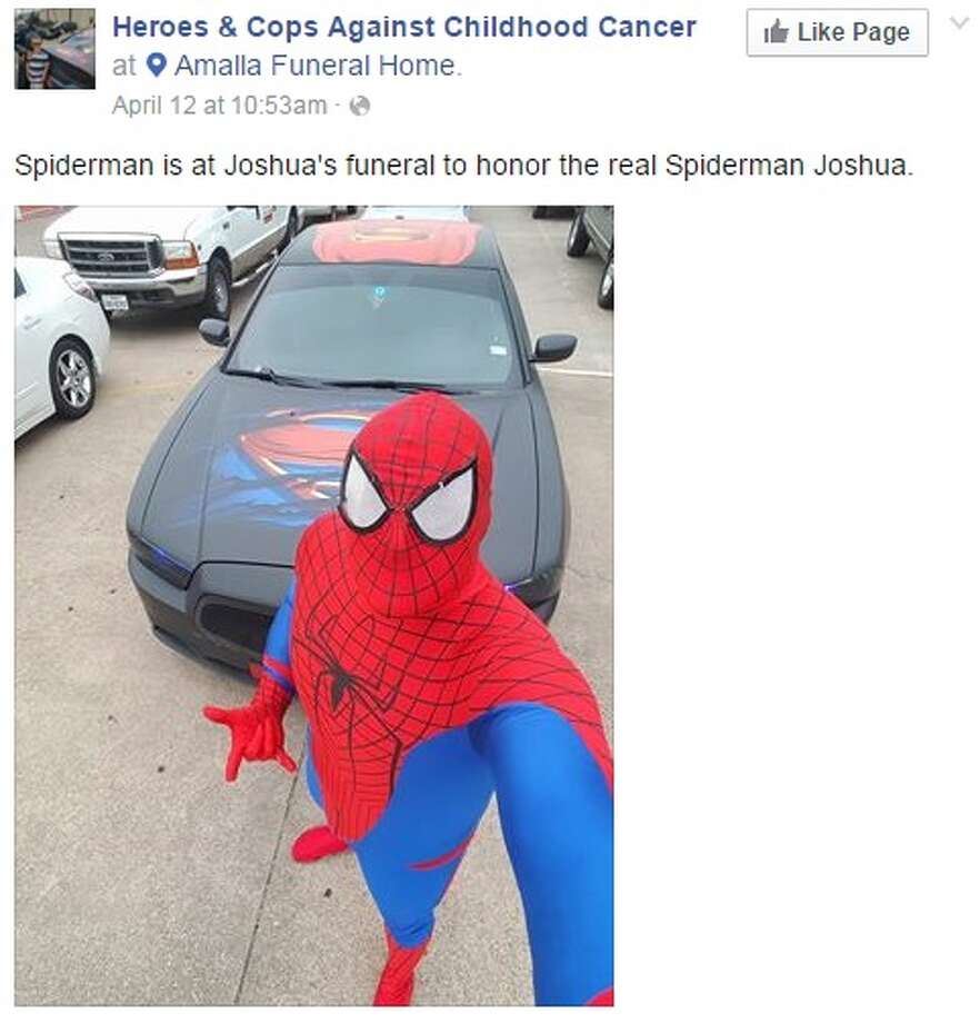 FWPD office Damon Cole at Joshua Garcia's funeral, dressed as Spider-Man, the child's favorite superhero.
