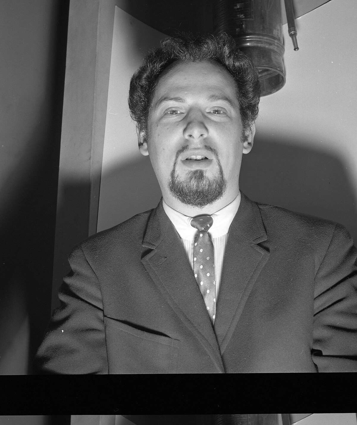 In 1964, Anton Szandor LaVey (born Howard Stanton Levey) was a 34-year-old ex-carny musician with deep interest in the occult. He had already adopted his trademark goatee but the shaved head would not come until 1966, when he founded his Church of Satan in San Francisco.