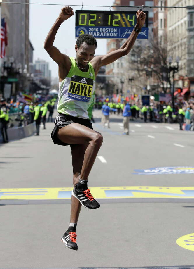 Lemi Berhanu Hayle, of Ethiopia, celebrates after winning the 120th Boston Marathon on Monday, April 18, 2016, in Boston. (AP Photo/Elise Amendola) ORG XMIT: BX235 Photo: Elise Amendola, AP / Copyright 2016 The Associated Press. All rights reserved. This m