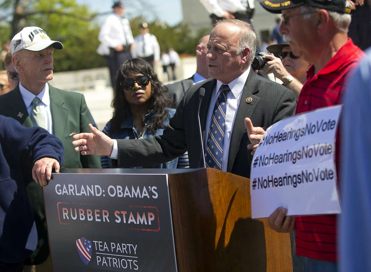 Rep. Steve King, R-Iowa, speaks to a small group of demonstrators opposing President Obama's immigration reform, outside the Supreme Court in Washington, Monday, April 18, 2016. The Supreme Court is taking up an important dispute over immigration that could affect millions of people who are living in the country illegally. The Obama administration is asking the justices in arguments today to allow it to put in place two programs that could shield roughly 4 million people from deportation and make them eligible to work in the United States.