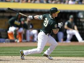 Oakland Athletics' Mark Canha swings against the San Francisco Giants during an exhibition baseball game Saturday, April 2, 2016, in Oakland, Calif. (AP Photo/Ben Margot)