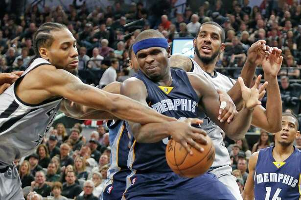 Kawhi Leonard of the San Antonio Spurs tries to strip Zach Randolph of the Memphis Grizzlies of the ball in Game 1 of the Western Conference playoff series at AT&T Center on April 17, 2016 in San Antonio.