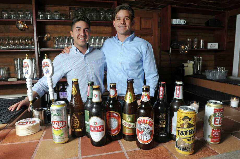 Owners Tim Tyrrell, left, and Adam Siemiginowski with a selection of their Polish beer offering at The Hill at Muza on Tuesday March 15, 2016 in Troy, N.Y. (Michael P. Farrell/Times Union) Photo: Michael P. Farrell / 10035764A