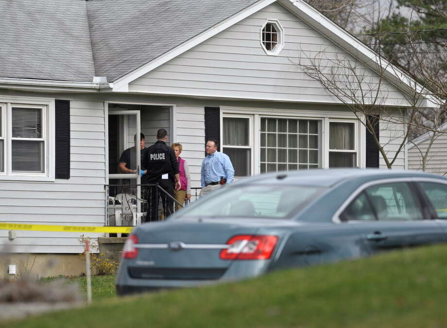 Bethel Police investigate at the site of a shooting on Governors Lane, in Bethel, Friday afternoon. One person was dead and two others were taken to the hospital following the shooting according to Bethel Police Chief Jeff Finch. March 25, 2016, in Bethel, Conn. Photo: H John Voorhees III / Hearst Connecticut Media / The News-Times