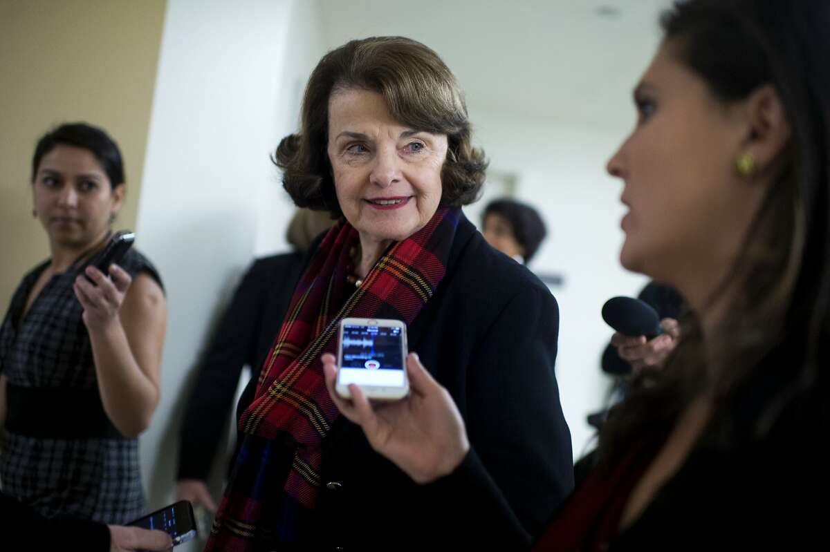 UNITED STATES - DECEMBER 08: Sen. Dianne Feinstein, D-Calif., talks with reporters in the basement of the Capitol before the Senate Policy luncheons, December 8, 2015. (Photo By Tom Williams/CQ Roll Call)