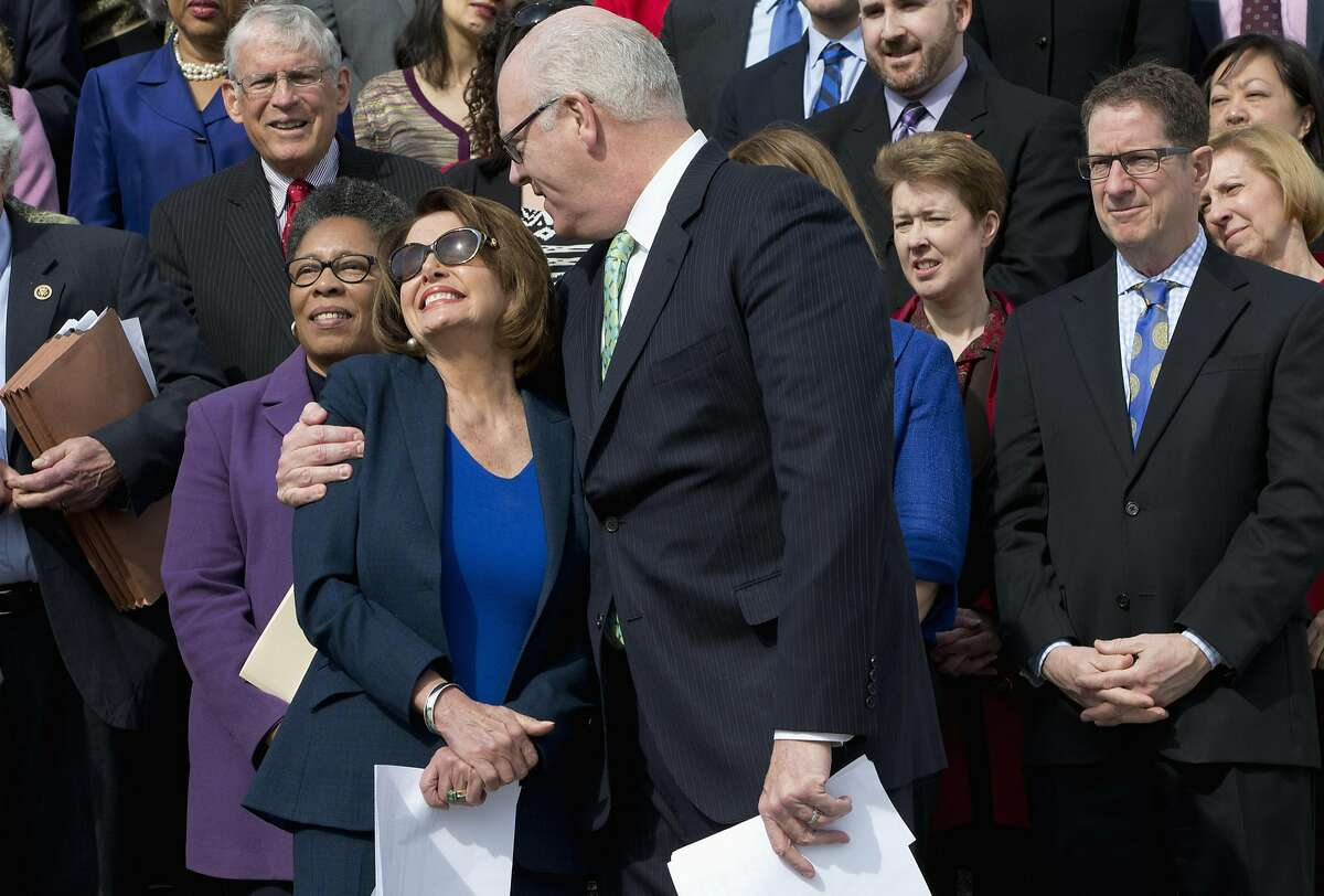 Rep. Joseph Crowley, D-N.Y. hugs House Minority Leader Nancy Pelosi of Calif. on the East Front steps of the Capitol in Washington, Wednesday, March 23, 2016, prior to a news conference on the sixth anniversary of the Affordable Care Act (ACA). (AP Photo/Jacquelyn Martin)