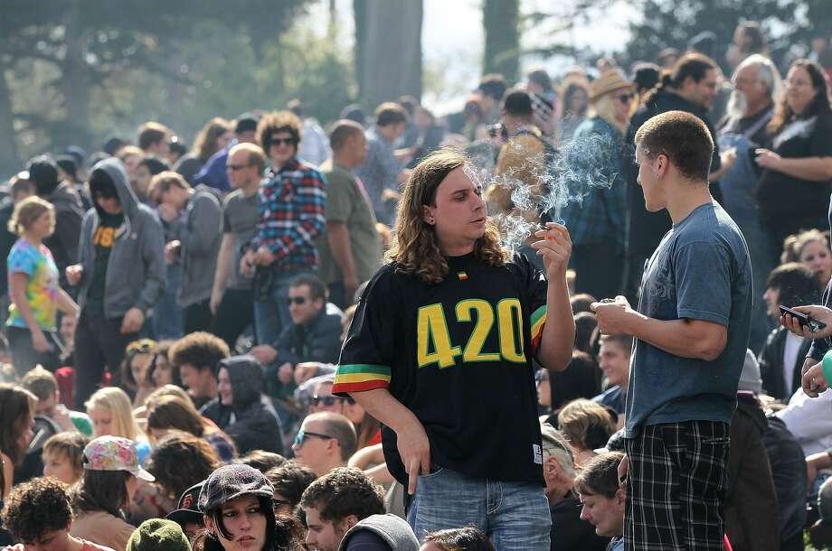 Smokers enjoy 420 on Hippie Hill, sans tickets.