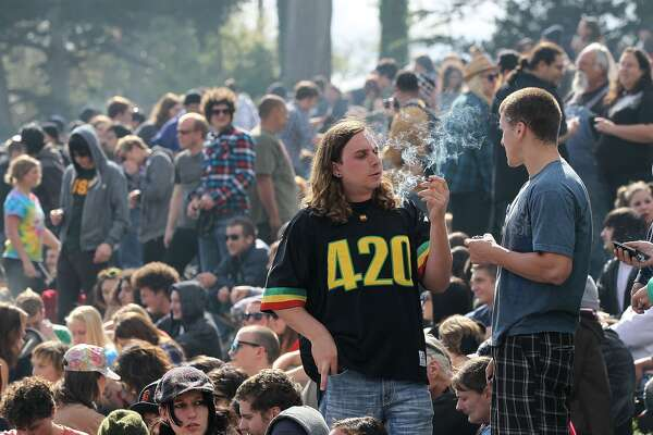 SAN FRANCISCO - APRIL 20: A marijuana user smokes marijuana during a 420 Day celebration on 'Hippie Hill' in Golden Gate Park April 20, 2010 in San Francisco, California. April 20th has become a de facto holiday for marijuana advocates, with large gatherings and 'smoke outs' in many parts of the United States. Voters in California will consider a measure on the November general election ballot that could make the State the first in the nation to legalize the growing of a limited amount of marijuana for private use. (Photo by Justin Sullivan/Getty Images)