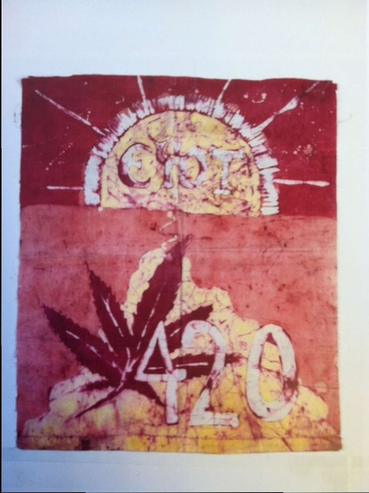 """The 420 flag, pictured here, was made by a friend of the Waldos named Patty Young in the 1970s. The phrase """"EYOT"""" at the top was mostly meaningless, but it became used as a substitute for 'It's all too weird and funny!'"""""""