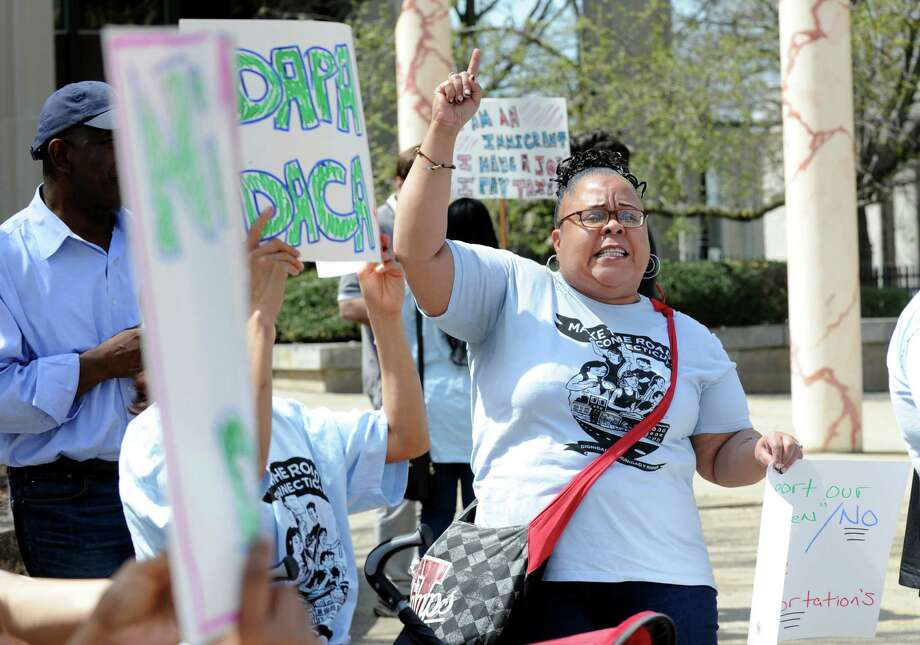 Claudina Lara leads a chant during an immigration protest at U.S. District Court in Bridgeport, Conn. on Monday, April 18, 2016. The peaceful gathering organized by Make The Road Connecticut, was called in response to U.S. Supreme Court hearing President Obama's executive order on immigration. Photo: Cathy Zuraw / Hearst Connecticut Media / Connecticut Post