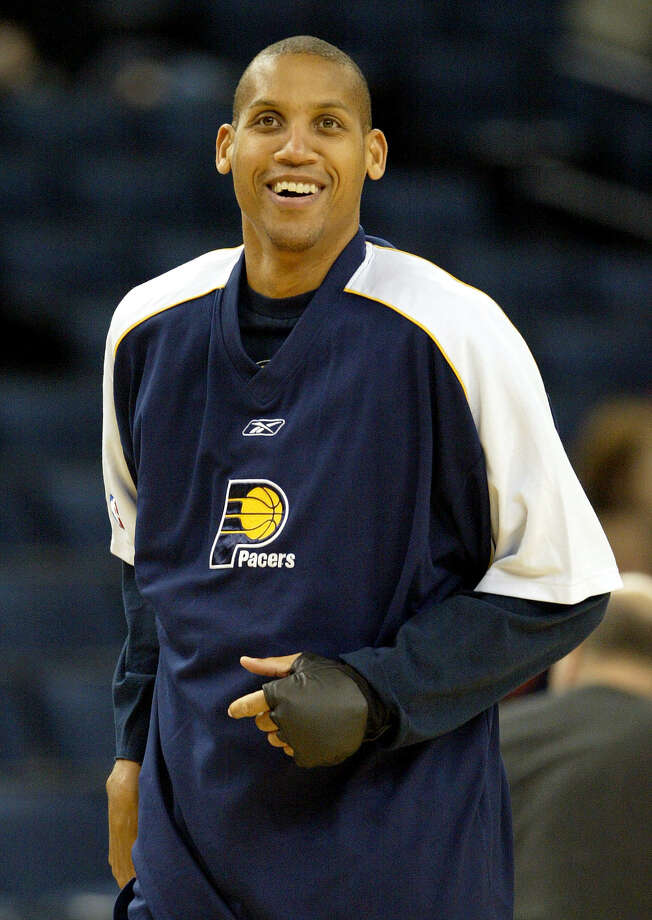 ** FILE ** Indiana Pacers' Reggie Miller warms up before the Pacers' game against the Golden State Warriors in Oakland, Calif., in this Dec. 4, 2004 file photo.  Miller will retire at the end of this season, his sister, Cheryl, reported Thursday, Feb. 10, 2005, on TNT. (AP Photo/Jeff Chiu) Photo: JEFF CHIU, Associated Press / AP