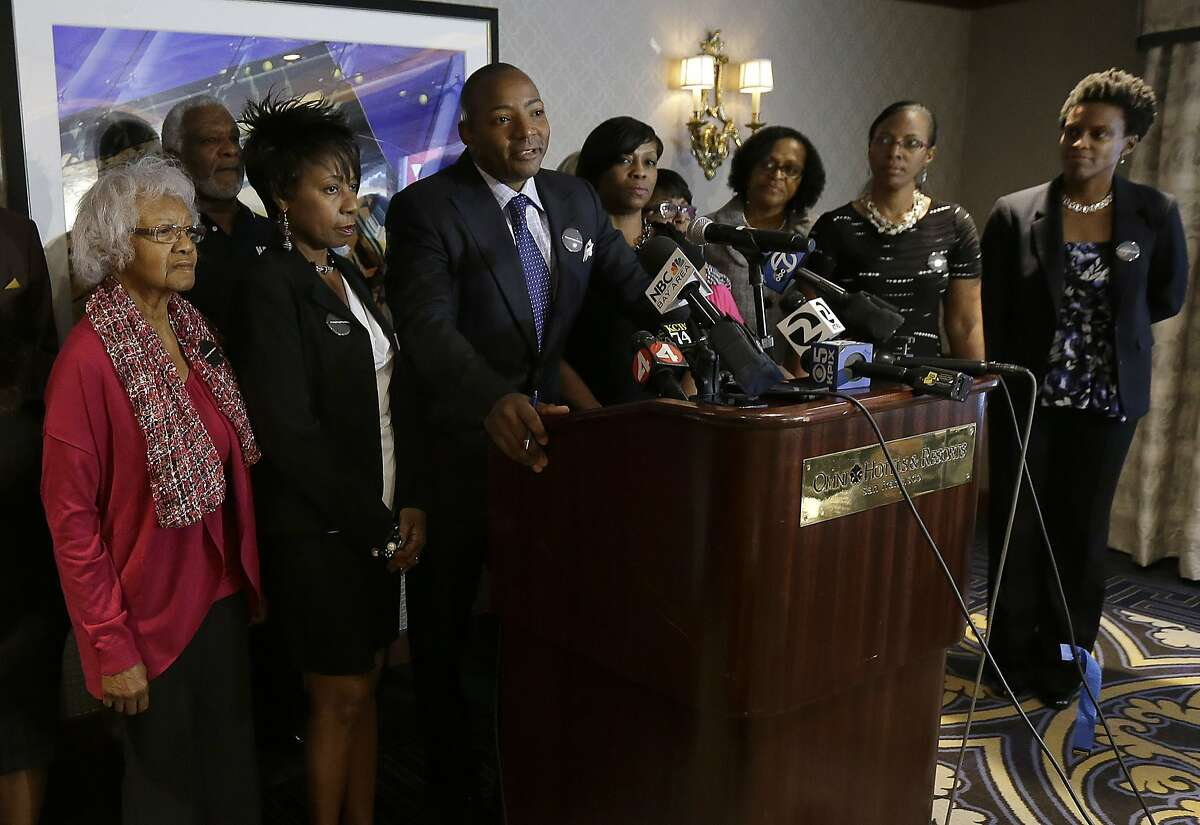 Attorney Waukeen Q. McCoy, center left, speaks with plaintiffs filing a lawsuit over their ejection from a Napa Valley Wine Train during a news conference in San Francisco, Thursday, Oct. 1, 2015. Also pictured are plaintiffs Katherine Neal, from left, Georgia Lewis, Lisa Johnson, Sandra Jamerson, Debbie Reynolds and Allisa Carr. The group of mostly black women, members of a book club, settled their lawsuit in April 2016 for an undisclosed amount.