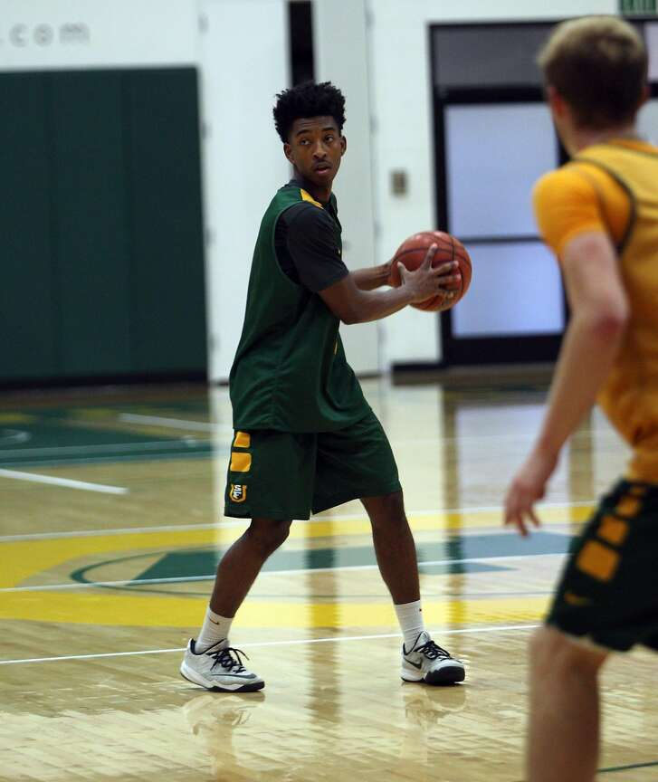 Sophomore guard  Devin Watson showing some hustle during practice  at the USF Memorial Gym. October 13, 2015
