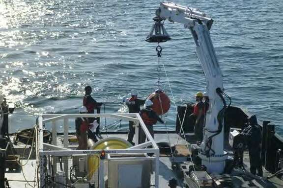 The syntactic sphere part of the scientific mooring, which contains an instrument that measures ocean currents,�as it is assembled and deployed Oct. 6, 2015.