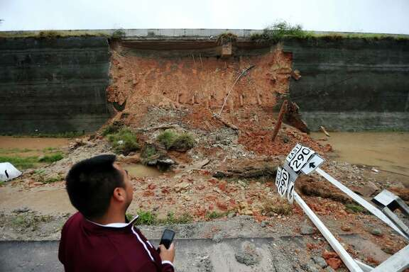 Edgar Peneda, of Roadway Construction, inspects a collapsed retention wall along eastbound U.S. Highway 290 at Huffmeister after heavy rain on Monday, April 18, 2016, in Houston, Texas.