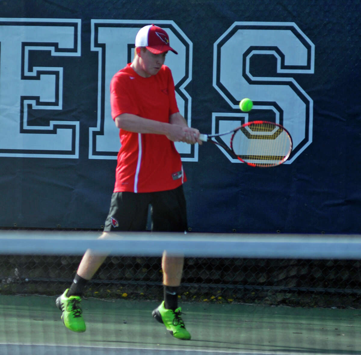 Greenwich's Tyler Dagnino returns a shot during a boys tennis game against Staples on Monday, April 18th, 2016.
