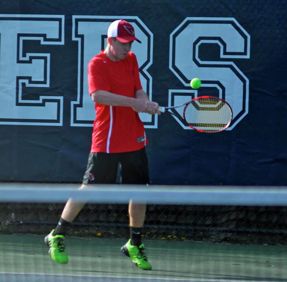 Greenwich's Tyler Dagnino returns a shot during a boys tennis game against Staples on Monday, April 18th, 2016. Photo: Ryan Lacey/Hearst Connecticut Media / Westport News Contributed
